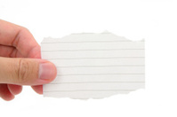 hand holding a piece of blank notepaper