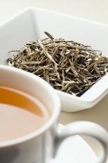 Japanese Bancha Green tea leaves behind cup of tea