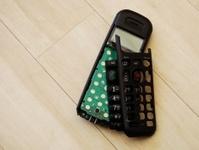 Broken phone handset on wooden floor