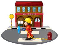 Fireman holding fire hose near a hydrant