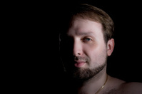 vintage-like low key male portrait with beard and hairy shoulder