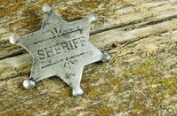 Sheriff Badge on Barn Board