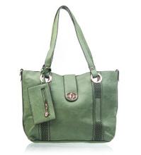 Green female handbag over white