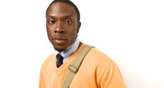 Black Male Portrait In Orange Sweater And Tie With Copyspace