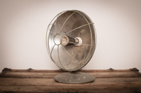 Vintage Heat Lamp Sitting on Wood Trunk