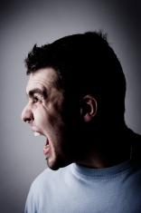 Side Profile Portrait of Man Screaming