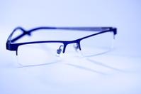 Eye glasses isolated on blue