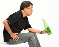 Holding an empty bottle