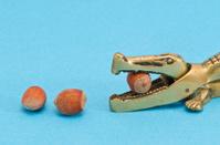 hazelnuts and nutcracker on azure background