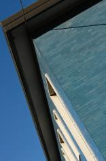 Cyan brick wall and blue sky