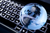 Glass earth globe on illuminated keyboard