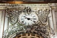 Big clock of rue Augusta arch at night