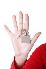 Home keys on female's hand. Close up.