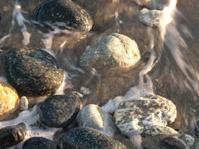 sea and the rocks at sundown