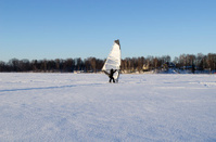 ice surfer man wind sail frozen lake winter sport