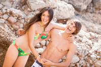 beautiful young couple having fun on the beach