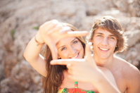 beautiful young couple having fun on the beach frame picture