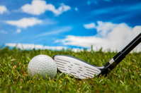 Golf stuff on sky background with intense light