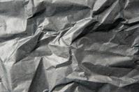 crumpled black paper