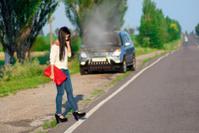 girl with a broken car
