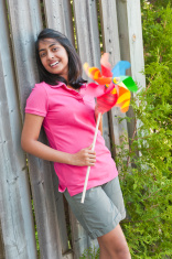 girl with pinwheel in outdoors