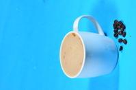 dark brown coffee drink and bean