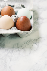 Colorful Organic Eggs in a Crate