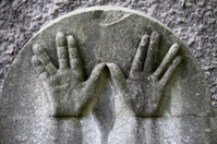 Hands on a Jewish grave stone