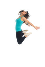 Dancer girl jumping high - isolated