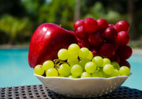 Apple and grape by the swimmimg pool