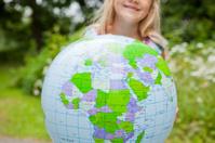 Girl holding an earth globe