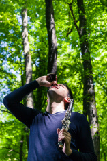 Man with clarinet looking up