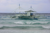 Outrigger boat in a stormy sea, Philippines