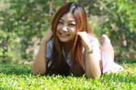 asia women lying on grass