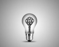 Old key in light bulb