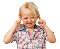 Sad boy blocking ears
