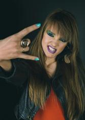 "Girl showing ""rock on"" gesture"