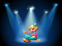 Stage with a female clown sitting at the center