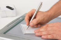 Write with pen in a notebook