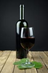 Bottle of wine and vine leaf