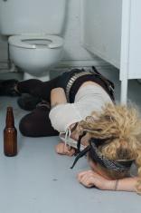 Drunk girl in a public toilet