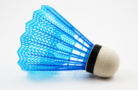 blue badminton shuttlecock on a white