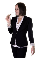 Woman smelling parfum