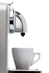 Cup of coffee and coffeepot