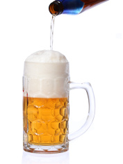 beer pouring into mug isolated on white