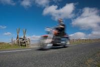 Classic motorcycle speeding on mountain road