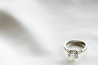 Diamond ring on white fabric