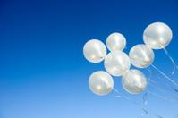 White Balloons in Sky