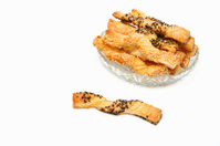 sweet puff pastry sticks  with sesame seeds