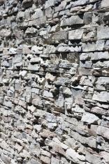 stony wall closeup in the sunshine - shallow DOF
